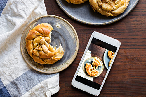 Almonds buns and a mobile phone