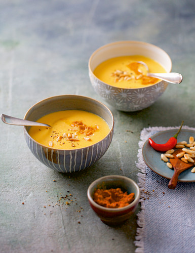 Cream of potato soup with orange and curried pine seeds