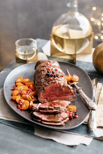 Roasted beef fillet with a spiced Barolo gravy and kumquat
