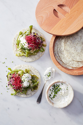 Chia tacos with green peppers, sprouts and sour cream and herb sauce