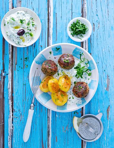 Bifteki with tzatziki and potatoes (Greece)