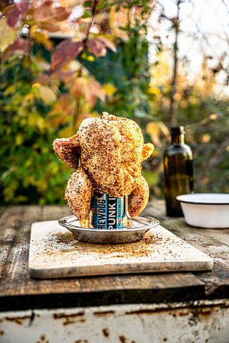 Uncooked beer can chicken