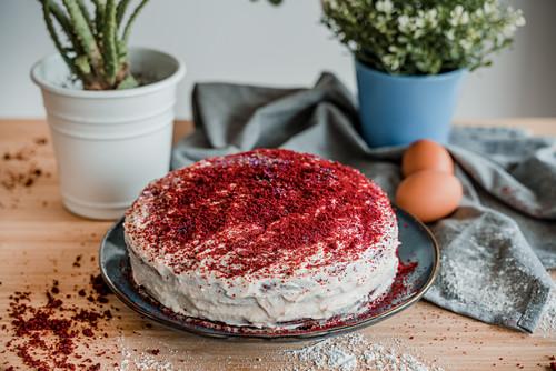 Yummy homemade red velvet cake on table in kitchen