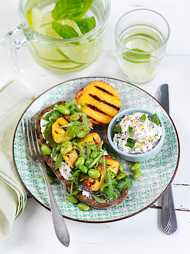 Grilled peach with edamame on bread