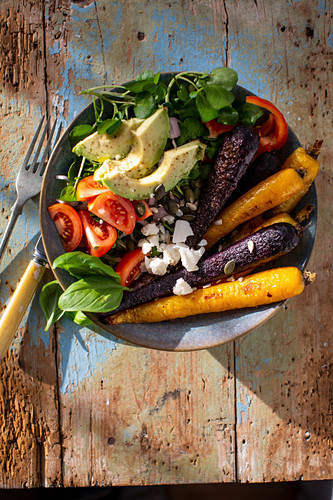 Vegetable bowl with roasted carrots, avocado and feta
