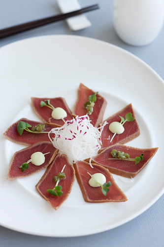 Japanese-style marinated tuna with wasabi sauce, wasabi and bean sprouts