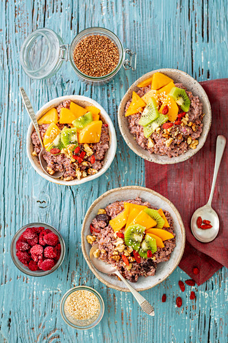 Buckwheat cooked with almond milk with raspberries, decorated with fruits