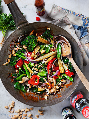 Asian vegetable wok with babycorn, broccoli, pepper, peanuts, onion and suger snaps