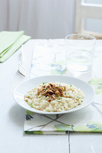 Creamy cheese risotto with fried thyme hazelnuts