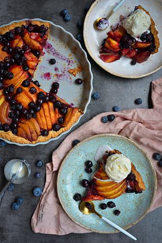 Fruit tart blueberries peaches ice cream scoop