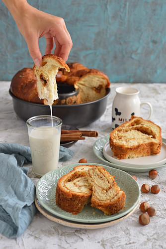 Roll cake with cinnamon a glass of milk