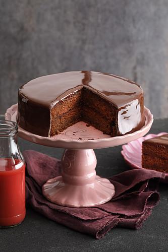A chocolate cake made with blood orange juice