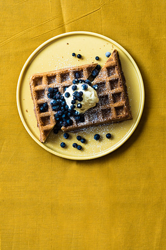 Waffles with salted caramel ice cream and blueberries