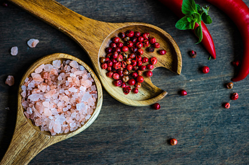 Cooking concept with spice ingredients on wooden table with copy space