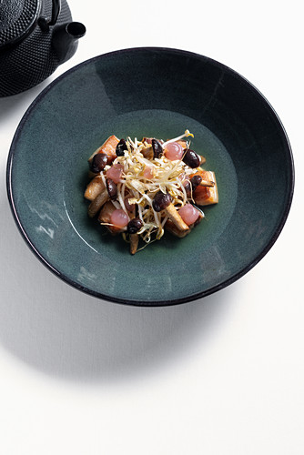 Pork belly with caramelized sprouts, beer jelly and hops tea