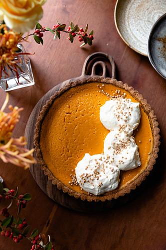 Gluten free pumpkin pie with whipped cream.