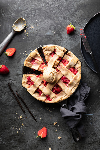 Strawberry and rhubarb tart served with peanut butter ice cream