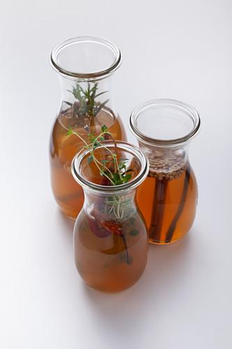 Homemade spiced vinegar and herb vinegar