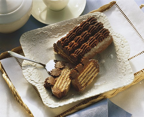 Cold dog (chocolate biscuit cake) on china dish
