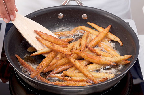 Finger pasta being fried in butter