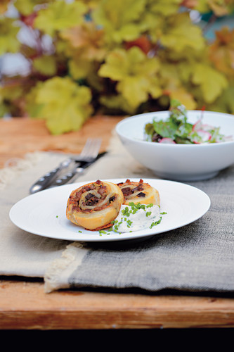 Puff pastry snail with wild boar