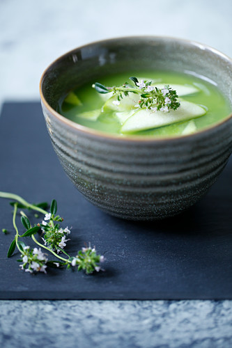 Matcha soup with green apples and cucumber in a small bowl