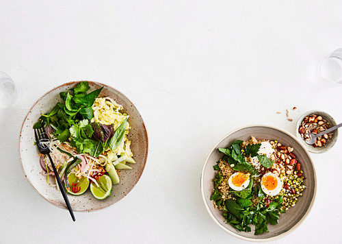 Rice noodle bowl and Quinoa salad bowl with almonds, sprouts and soft boiled egg