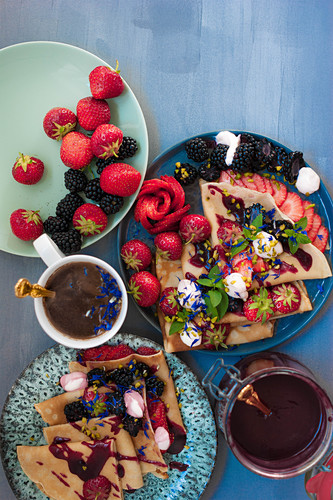 Crepes with jam, berries and pistachios