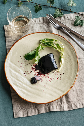 Carp with a black squid and blackberry glaze