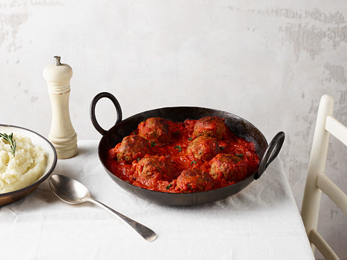 Meatballs in tomato sauce with mashed potatoes