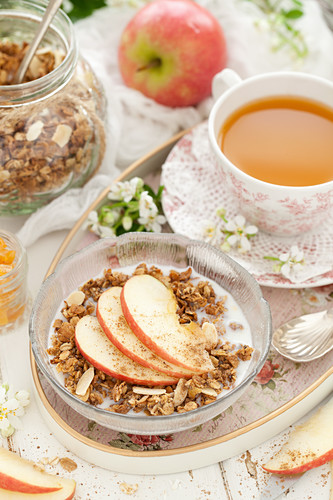 Apple Granola with Milk Apple Slices and a Cup of Tea
