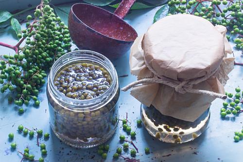 Elderberries preserved in brine (green elderberry capers)
