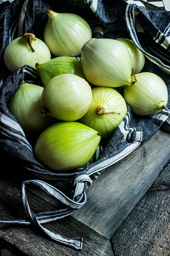 Onions in a black linen bag