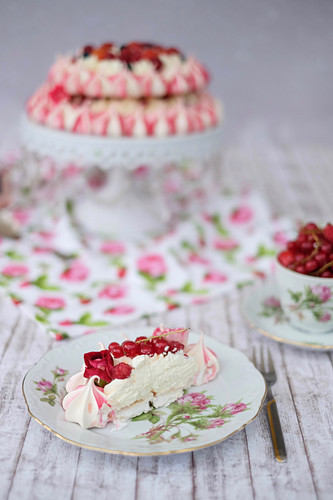 A festive pavlova with red berries and rose syrup