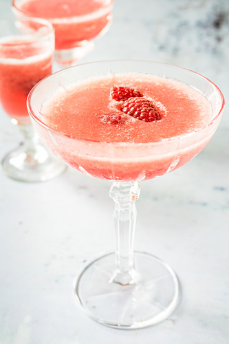 Frozen rosé wine with raspberry syrup and raspberries