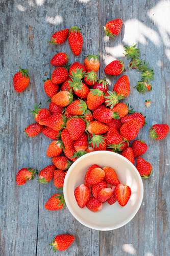 Fresh strawberries outside on a blue wooden table
