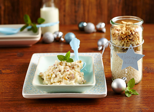 Ingredients for spicy apple rice pudding in a jar as a Christmas present and made in a bowl