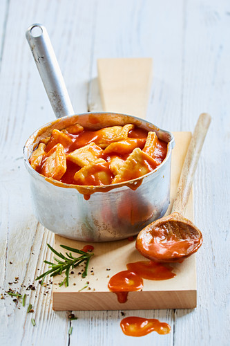 Ravioli with tomato sauce from a tin in a pan