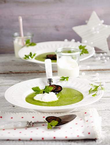 Pea and parsley soup with candied walnuts and crème fraîche