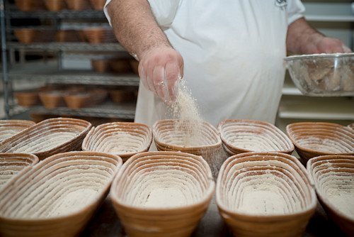 Chef Flouring the Proving Basket
