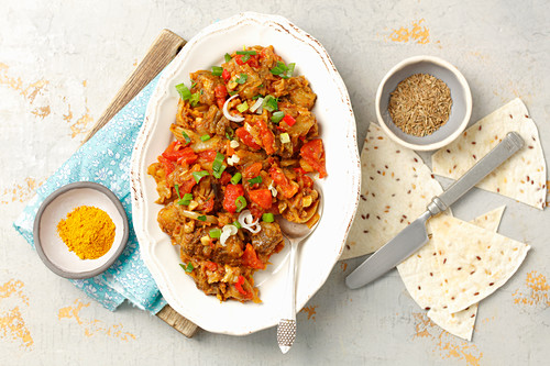 Indian style aubergine with tomatoes