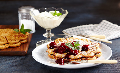 Cinnamon waffles with spiced red wine cherries and whipped cream
