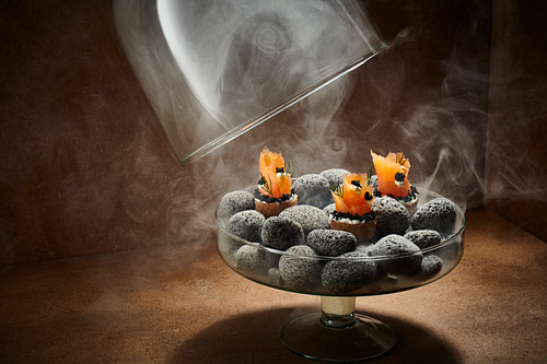 Salmon canapés smoked under a glass cloche