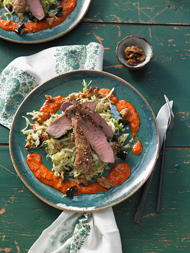 Green pointed cabbage salad with roasted plums, Brazil nuts, wild boar fillet and a chilli dressing