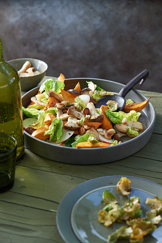 Warm sweet potato salad with fried king trumpet mushrooms, macadamia nuts and Brussels sprouts crisps