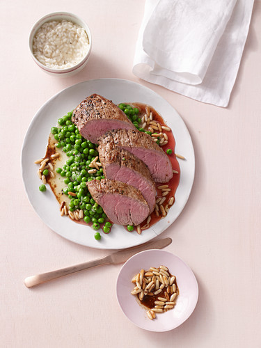 Beef fillets with pine nut butter and chervil peas