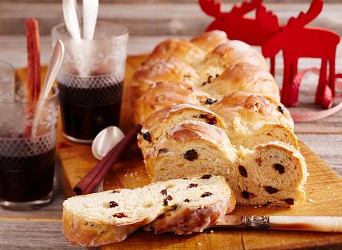 Raisin bread plait with icing (Christmas)