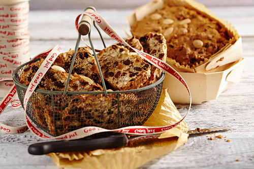 Mini fruit bread in a metal basket and a wooden basket