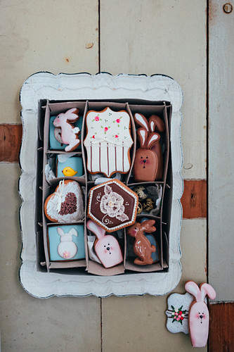 An Easter cookie box filled with royal icing cookies like Easter rabbits