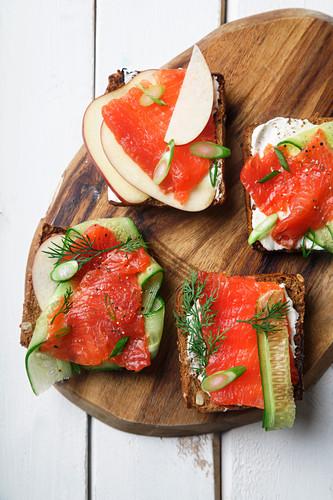 Danish smorrebrod with salmon, cucumbers and cream cheese